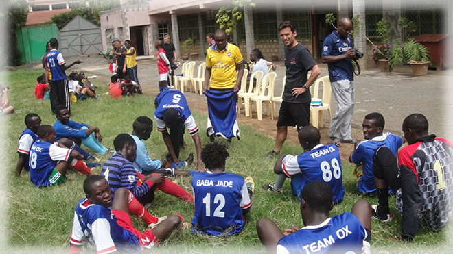 Football Coach from Oure Academy teaching at the Sadii Oval Sports Centre in Nairobi