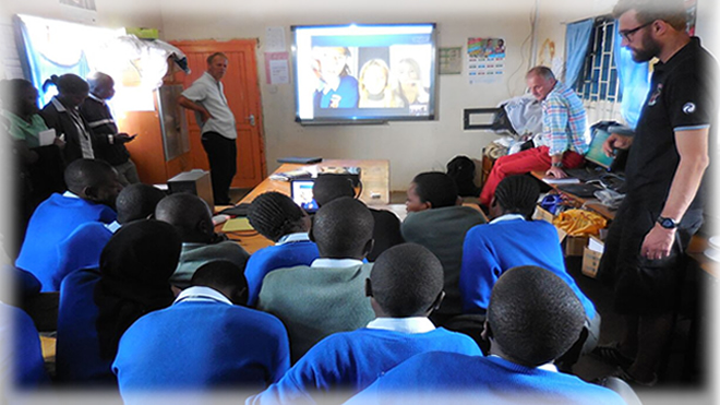 The Danish teachers on a visit to Raila educational Centre and here they are facilitating a Skype session between Kenyan students and Danish students