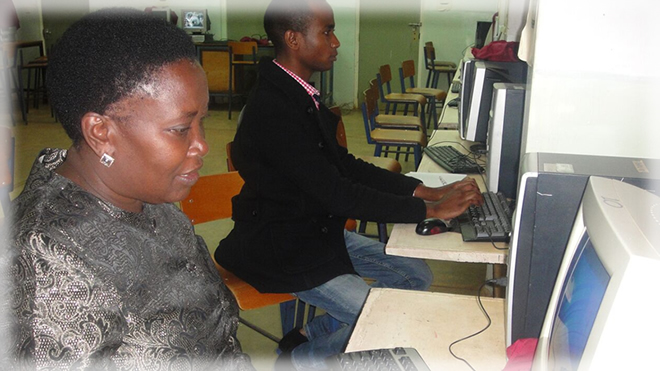 Associates from Kijani setting up a Skype session at one of the teacher training colleges in Kenya
