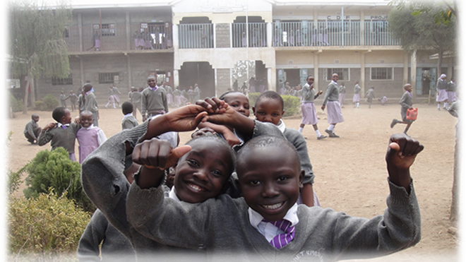 Students from Umoja Primary, during their 10 a.m. break time, in Nakuru where we send out the students for TTC annually