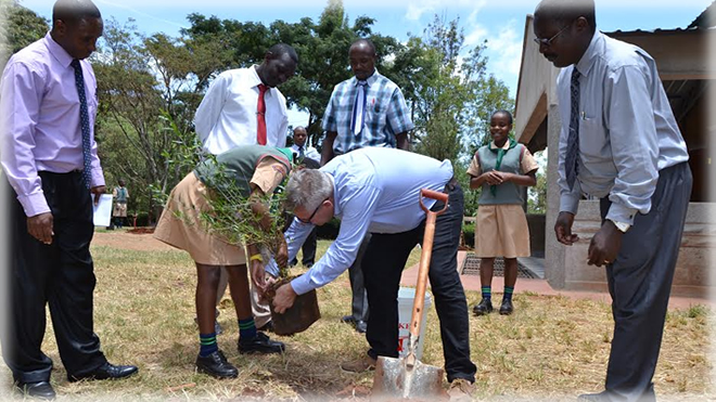The principal from Hunderup Skole planting a tree at NGSA